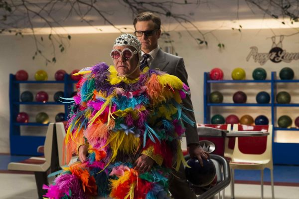 "Elton John, left, and Colin Firth star in Twentieth Century Fox's ""Kingsman: The Golden Circle."""