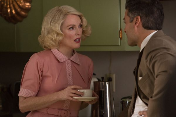 Left to right: Julianne Moore as Margaret and Oscar Isaac as Bud Cooper in SUBURBICON, from Paramount Pictures and Black Bear Pictures.